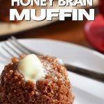 Image of honey bran muffin on plate with fork with pat of melting butter and more muffins behind.