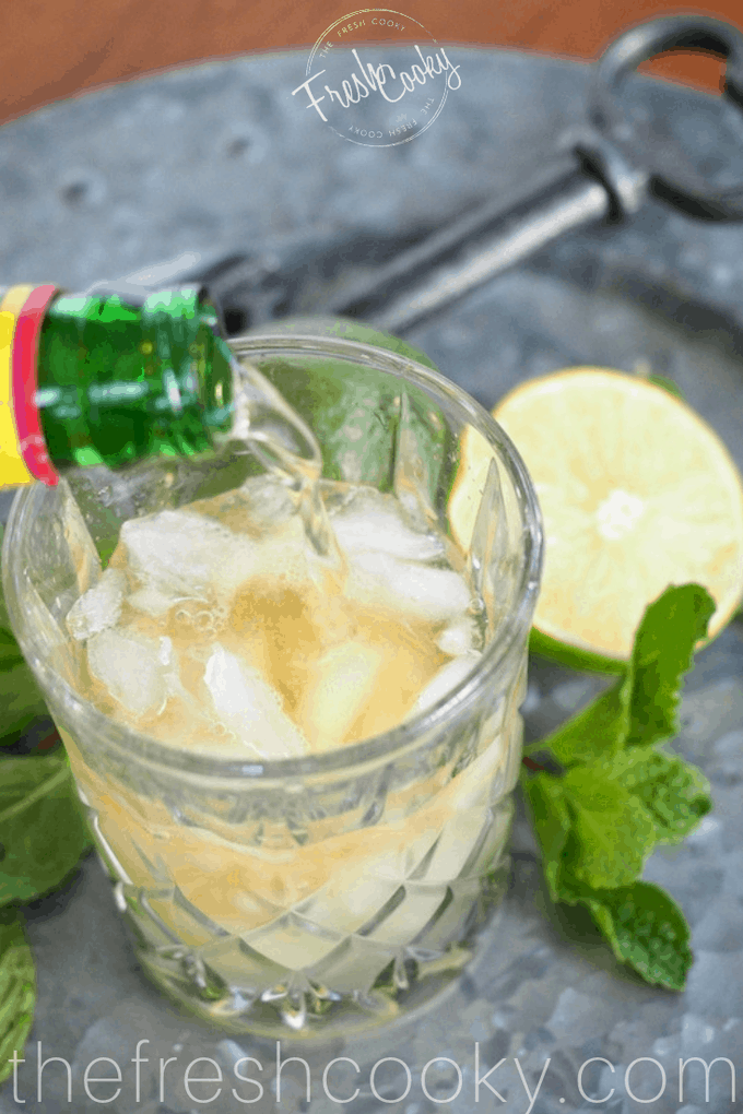 Pouring in Ginger BEer for Irish Whiskey Mule | www.thefreshcooky.com