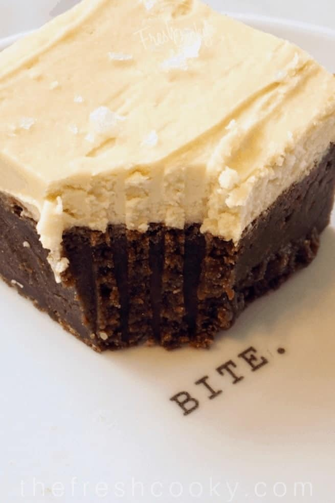 """Milk Stout Brownies with bite taken out  on a white plate that says """"bite"""""""