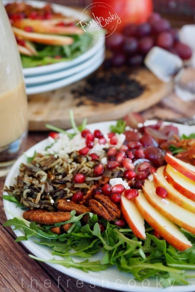 plated wild rice, harvest salad with apples, pecans, goat cheese, bacon and pomegranates