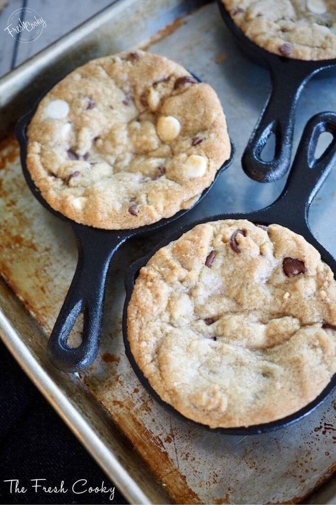 Close up of slightly golden baked chocolate chip cookies in mini skillets. https://www.thefreshcooky.com/key-lime-torte/