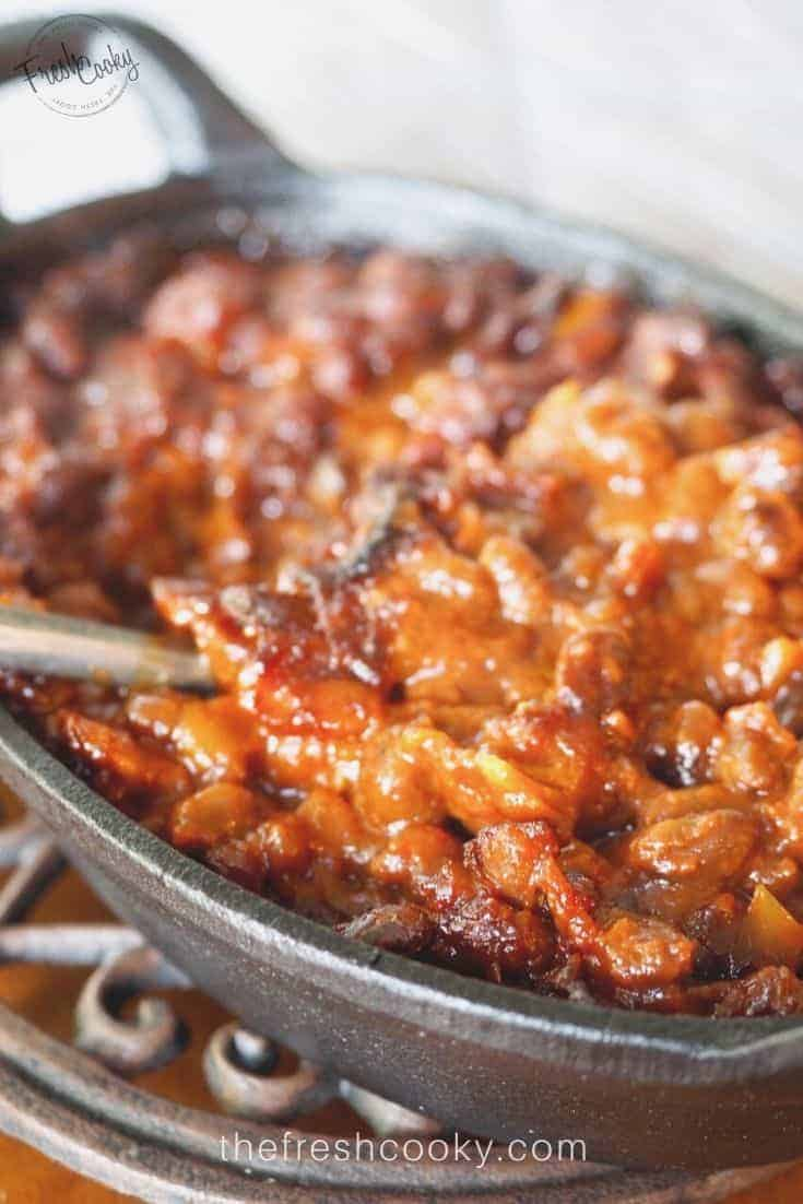 These easy Cowboy Baked Beans are simple since they are enhanced canned baked beans. Recipe via @thefreshcooky | #beans #bbq #potluck #barbecue #summer #easyrecipes #bacon via @thefreshcooky