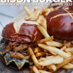 Pin for Best Ever Juicy Bison Burgers with image of burgers on a tray with crispy french fries around.