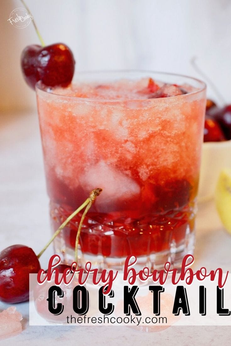 Pinterest Image for Cherry Bomb with fresh cherry on side of cocktail glass filled with the beverage.