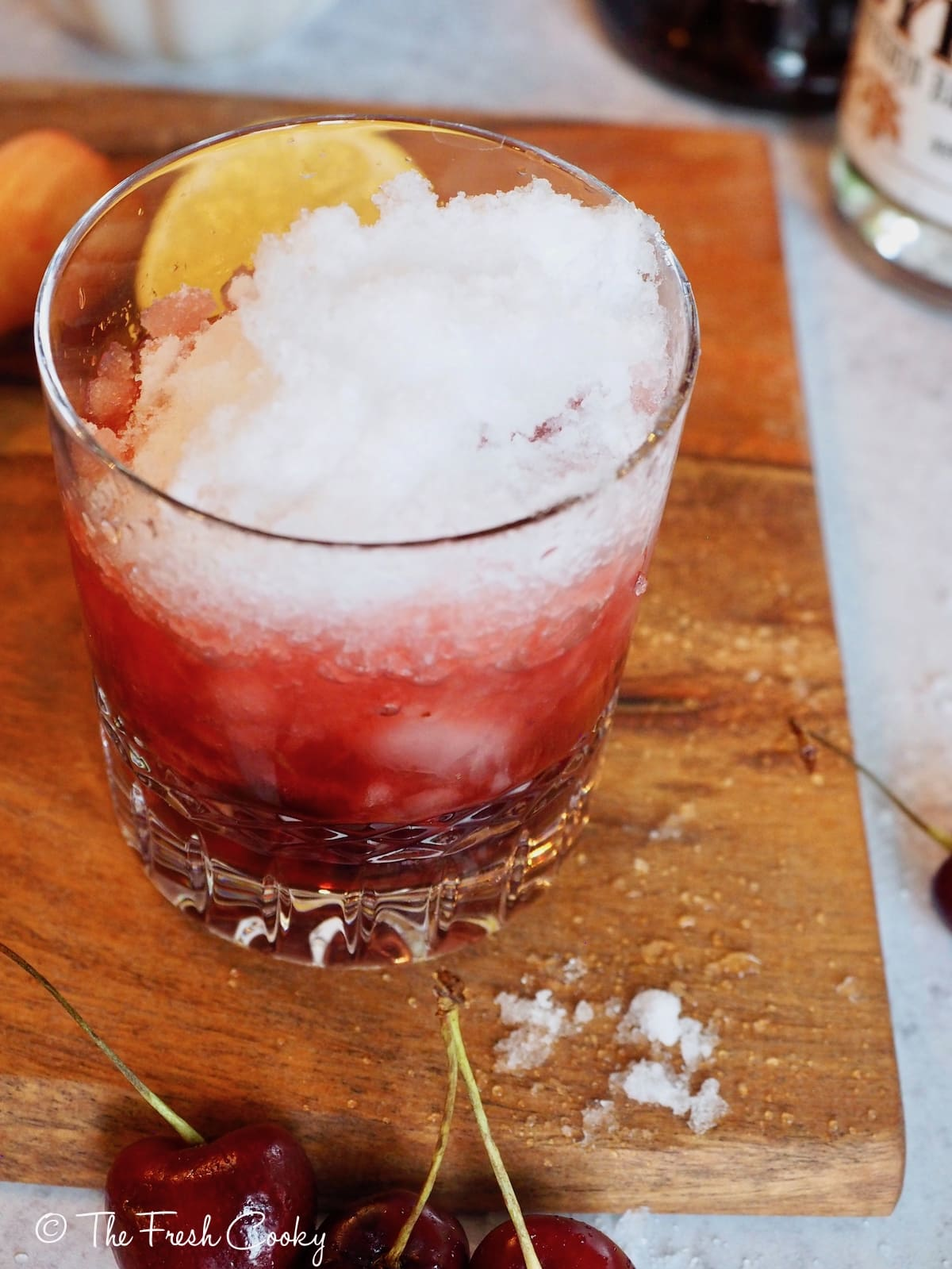 Crushed ice into cocktail glass | thefreshcooky.com