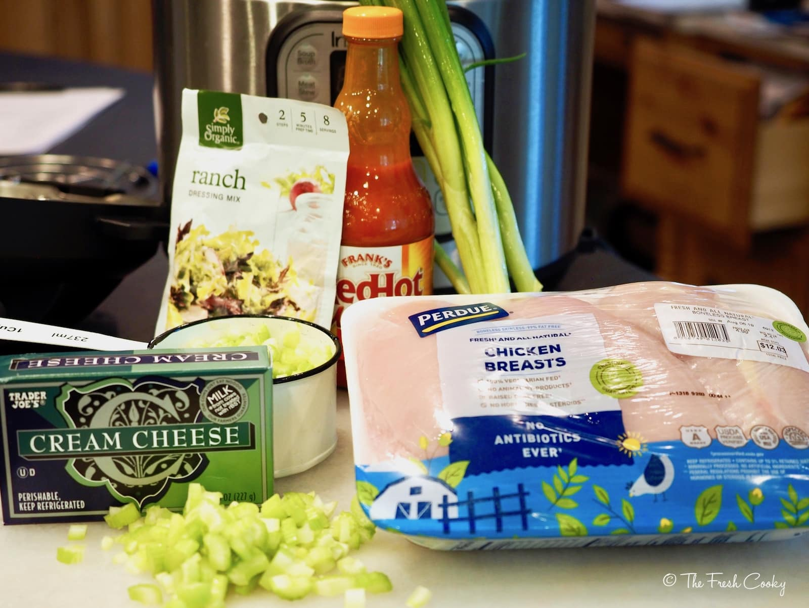 ingredients for buffalo chicken sliders. cream cheese, ranch dressing, celery, buffalo sauce and chicken breasts | thefreshcooky.com