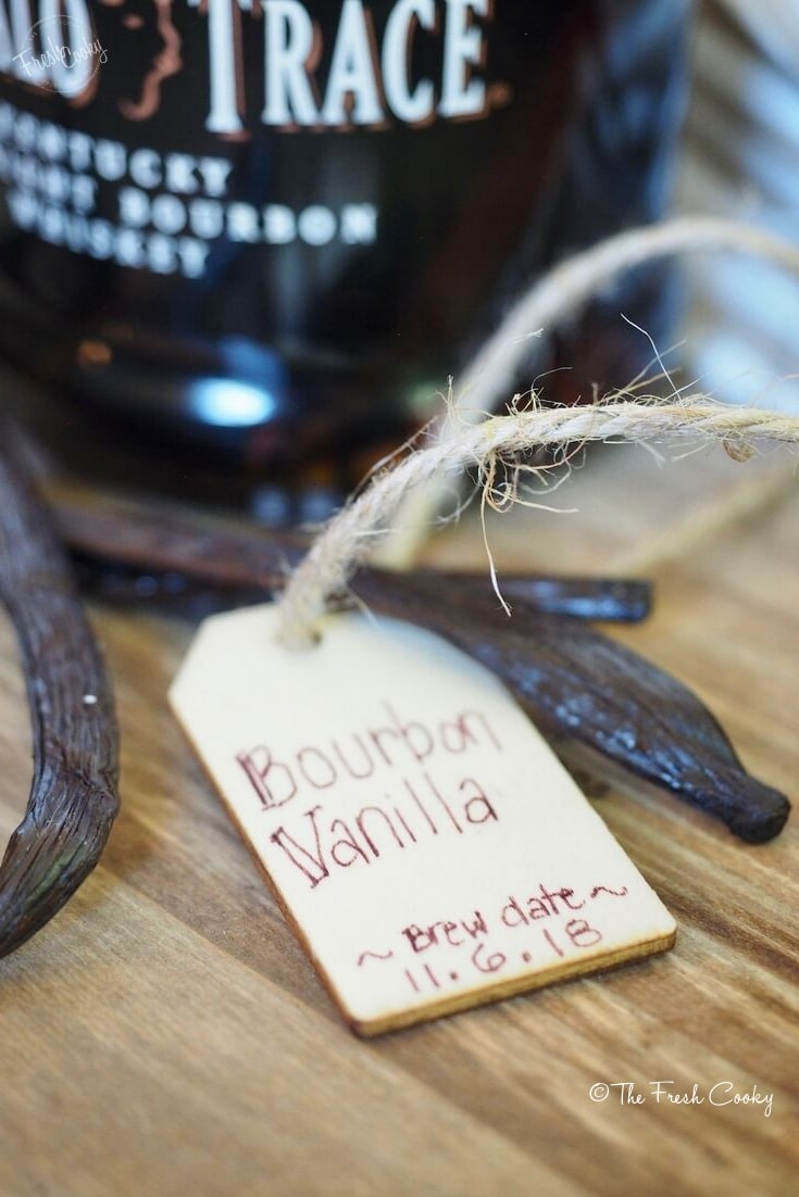 wooden tag for bourbon vanilla extract with beans and bourbon bottle | thefreshcooky.com