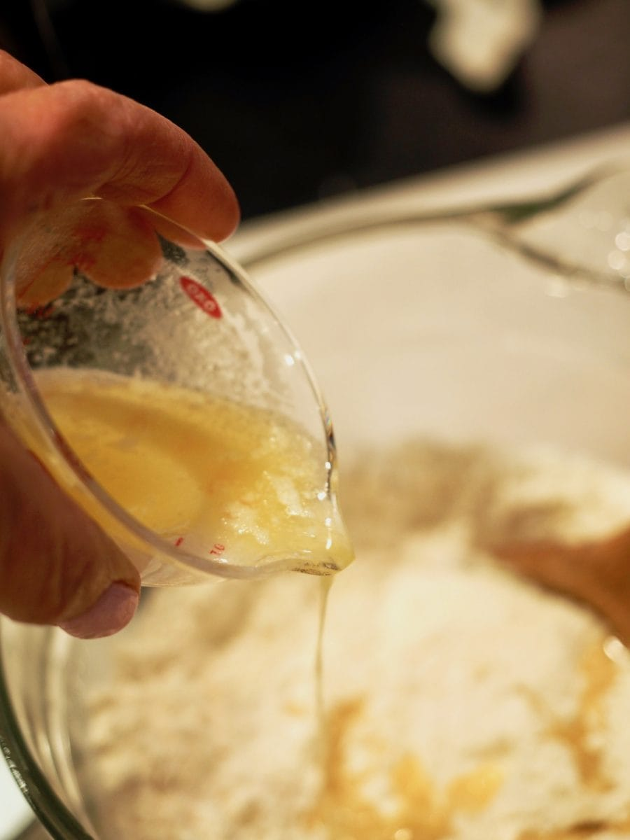 pouring in melted butter into beer bread mixture | thefreshcooky.com