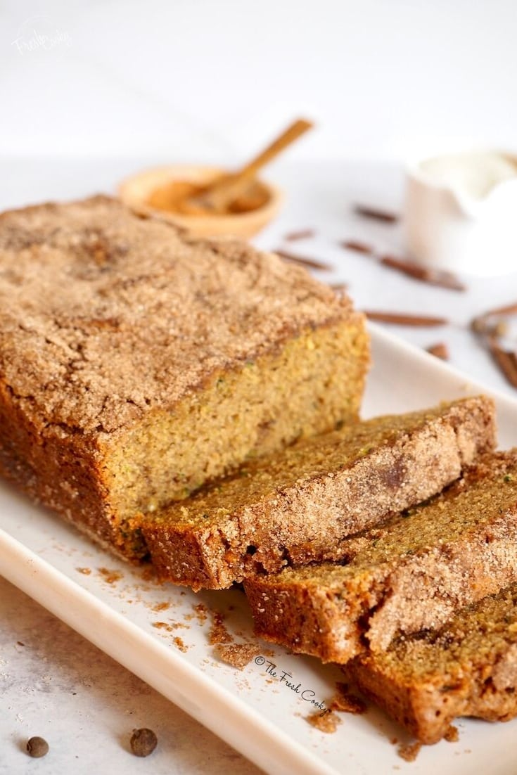 sliced loaf of cinnamon zucchini bread | www.thefreshcooky.com