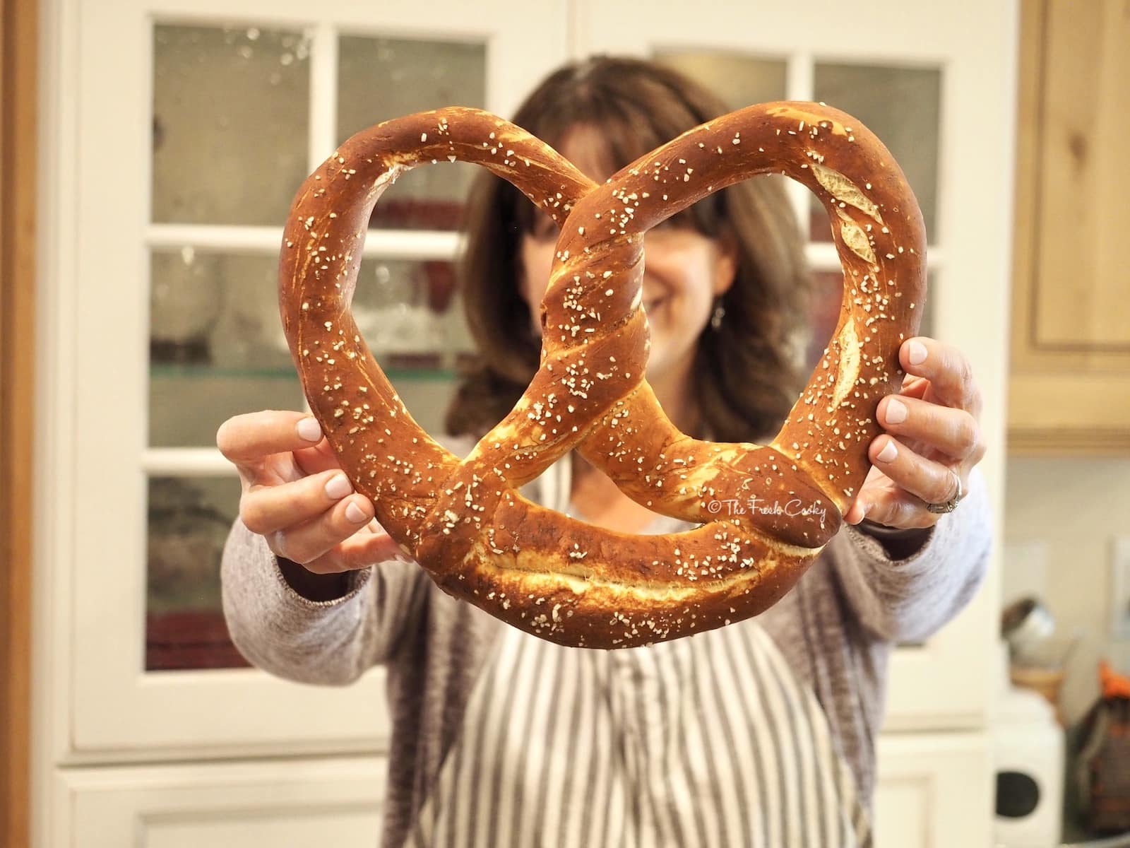 Holding large finished German Pretzel | via @thefreshcooky