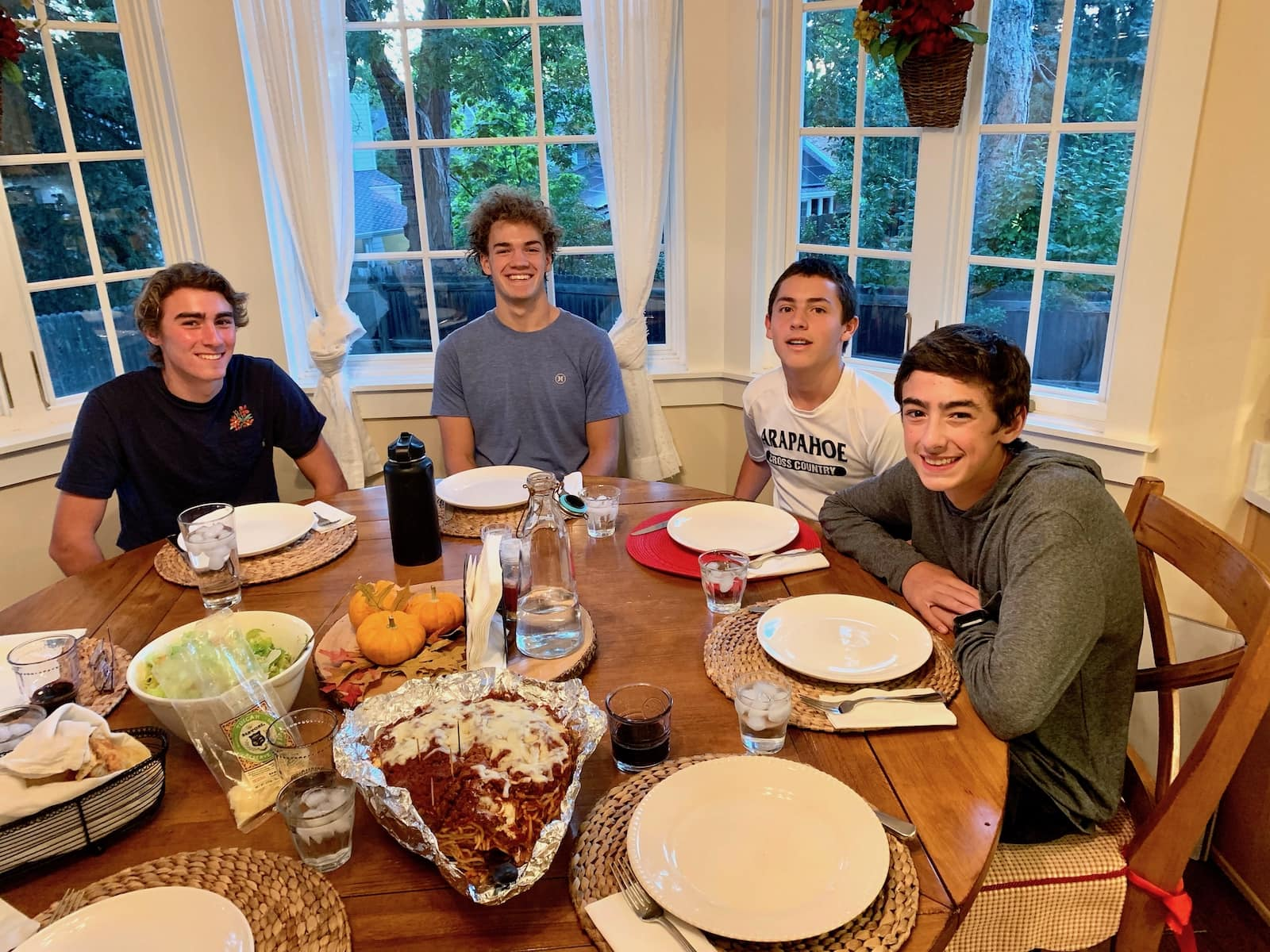 Image of our kids and friends at the dinner table with the spaghetti pie.