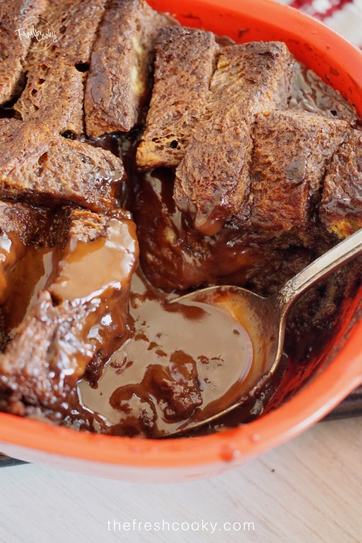 chocolate bread pudding, with gooey spoonful of bread pudding