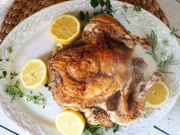 Instant Pot Roasted Whole Chicken with lemons and fresh herbs | thefreshcooky.com