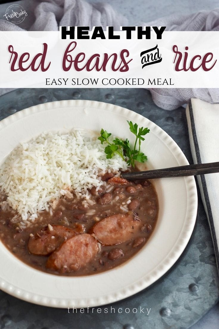 Pin for Slow Cooker Healthy Red Beans and Rice and easy slow cooked meal, image of slow cooked red beans and white rice in a bowl with a rustic spoon.
