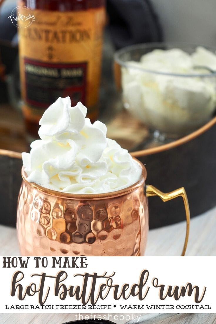 Copper mug with hot buttered rum, topped with a generous dollop of fluffy whipped cream