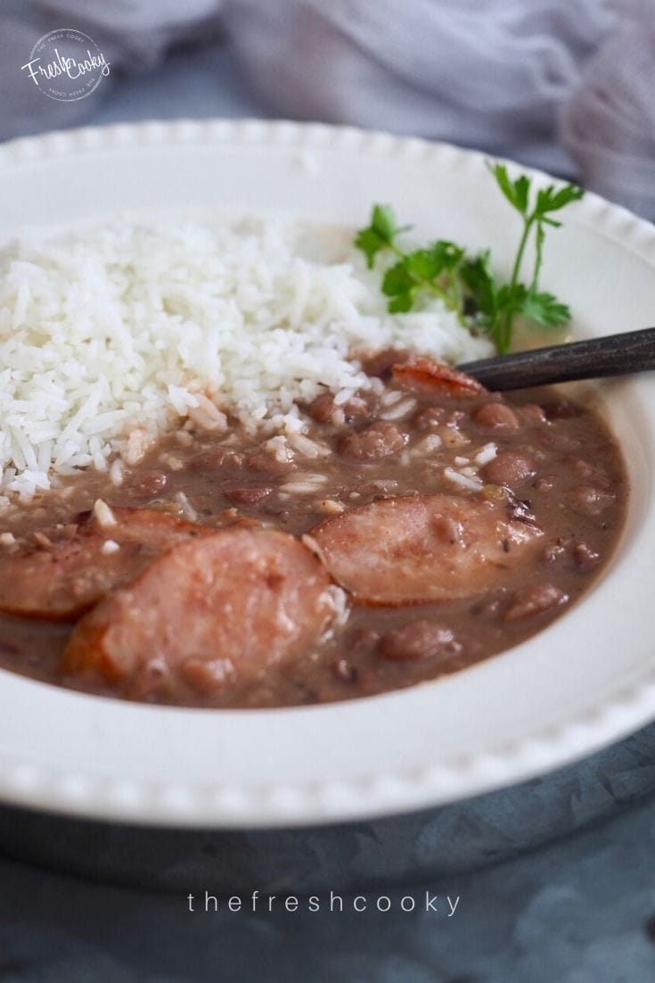 Large bowl filled with white rice and red beans and kielbasa sausage for Slow Cooker Red Beans and Rice.
