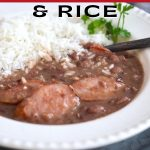 Pin for the Best Red Beans and Rice with image of slow cooked red beans and rice in a bowl with parsley and white rice.