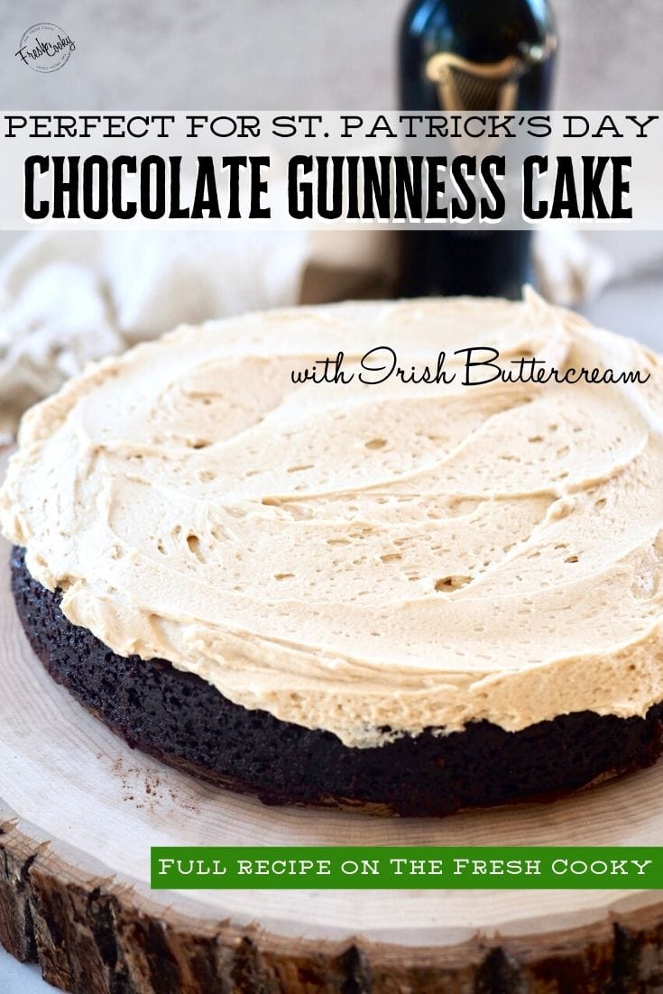 Pinterest Pin for Guinness Chocolate Cake with Irish Buttercream with image of single layer chocolate cake sitting on wooden pedestal with Guinness beer bottle in background.