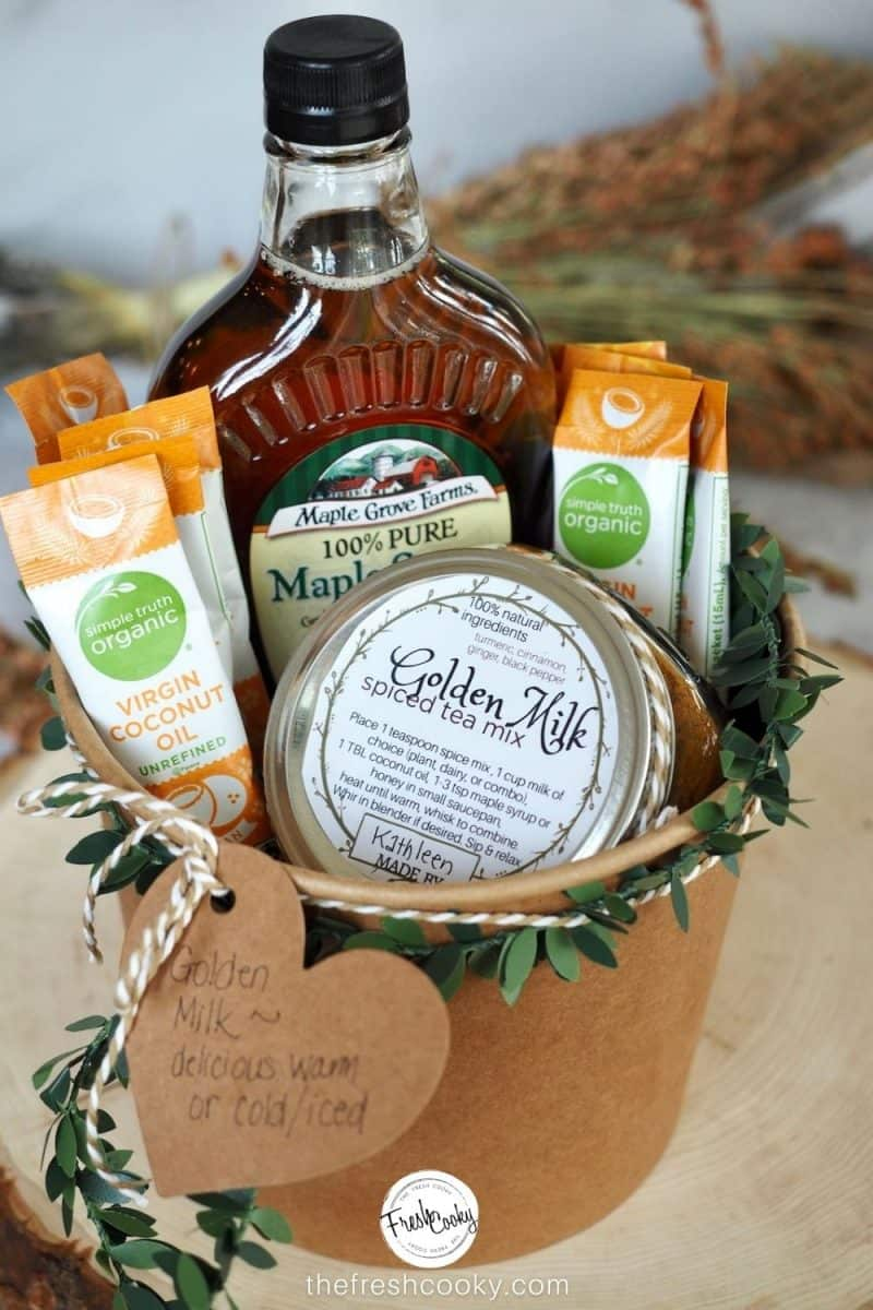 Golden Milk Spice Mix gift basket, filled with the spice mix in a jar, packets of coconut oil and maple syrup in a kraft paper bucket.