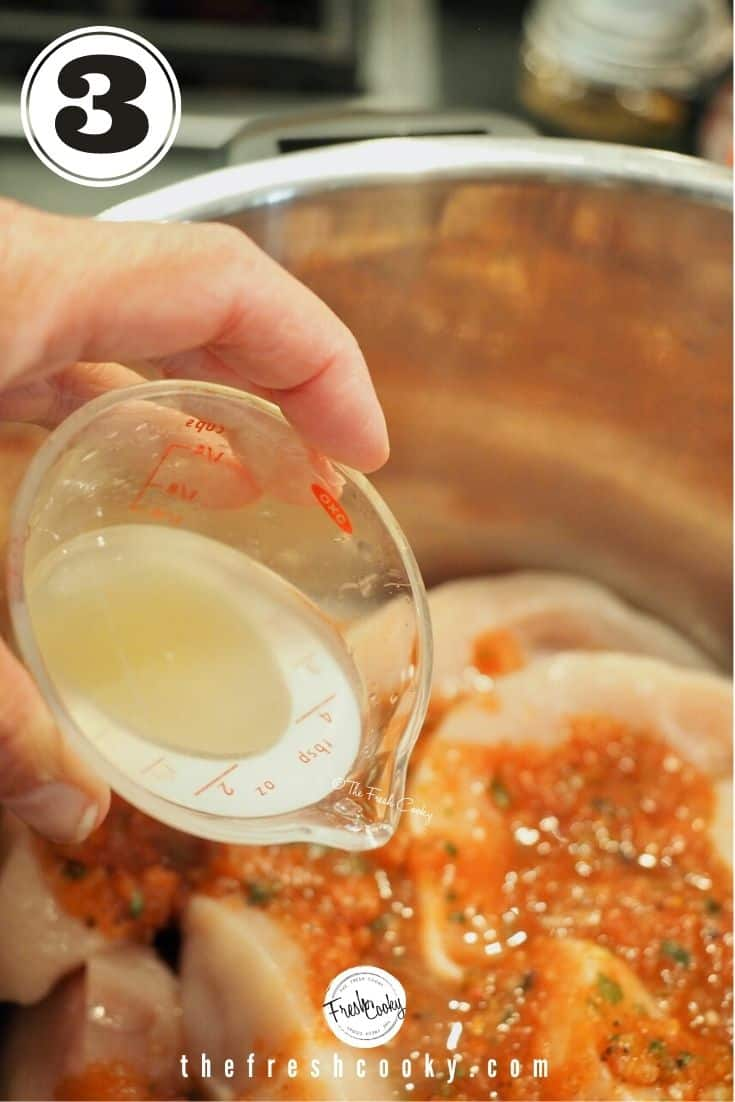 A mini liquid measuring cup with lime juice being poured over chicken with salsa