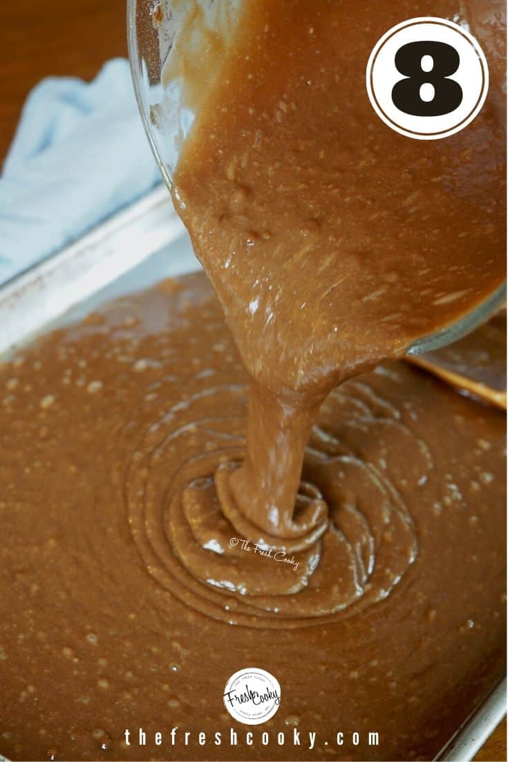 Pouring chocolate cake batter into prepared sheet pan