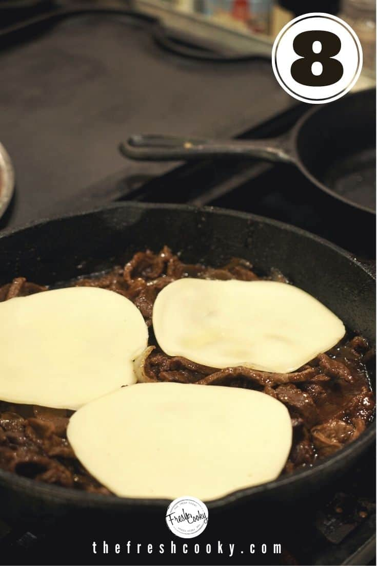 topping with slices of provolone cheese