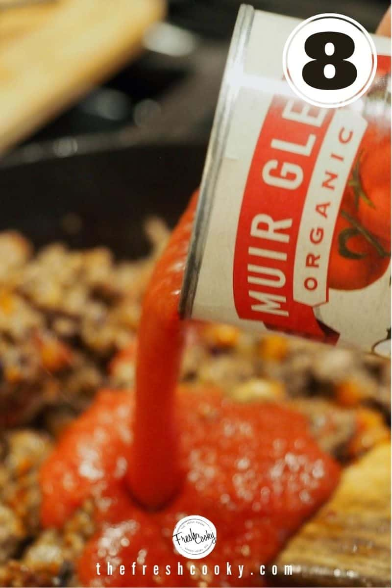 Pouring Tomato Sauce into skillet with browned ground beef