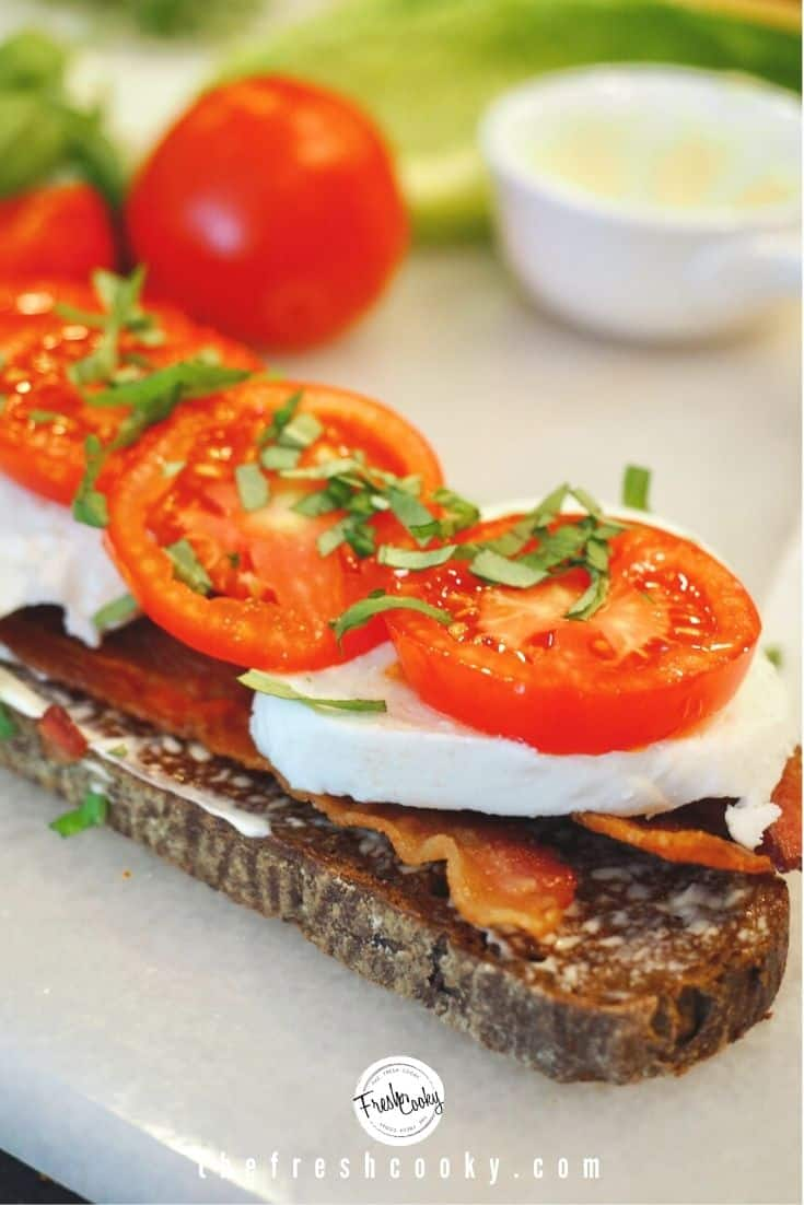 pumpernickel toast with mayo, bacon, mozzarella, tomatoes and chopped fresh basil.