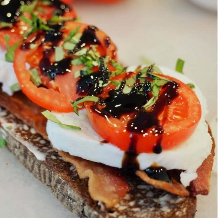 Image of bacon lettuce and tomato sandwich, with mozzarella cheese, basil and balsamic glaze