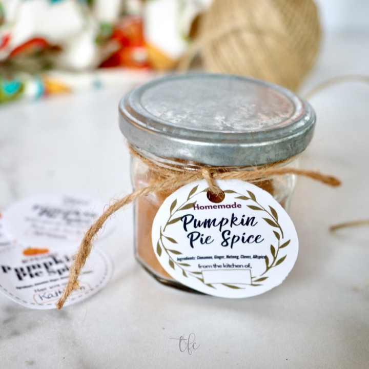 Square image of pumpkin pie spice substitute in a jar with a pretty gift tag.