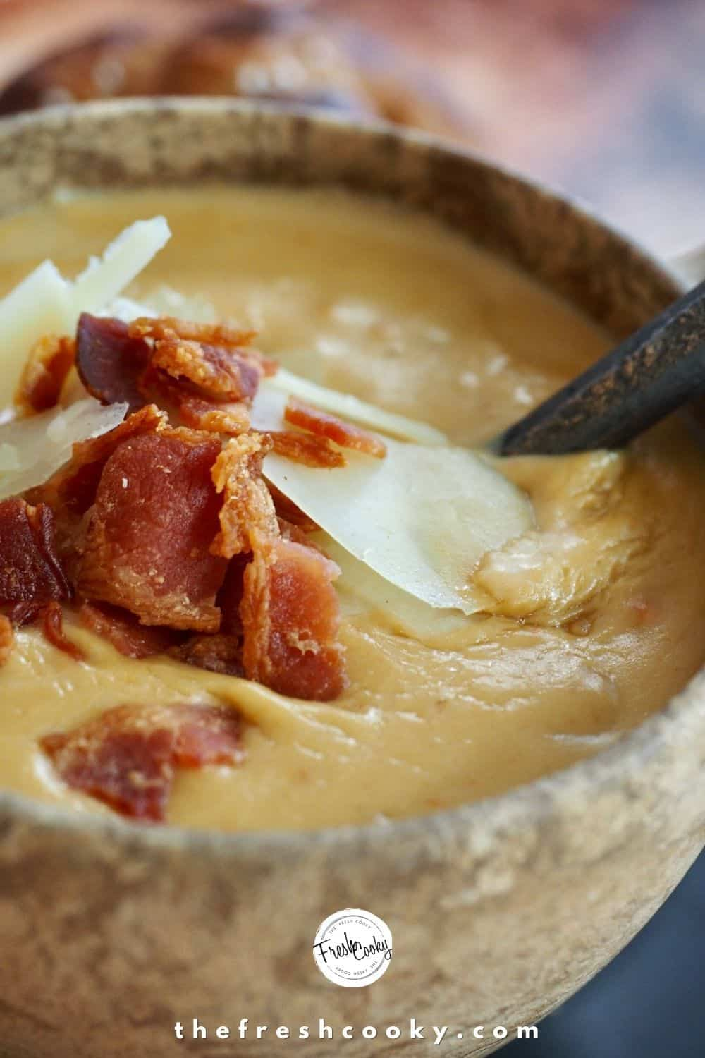 A hearty and delicious traditional German Beer Cheese Soup perfect for Oktoberfest! All natural creamy, easy cheese soup, using white cheddar cheese, bacon, chicken stock - it's the best fall comfort food soup! Great for parties, or a chilly Fall dinner or lunch. #thefreshcooky #fallsouprecipes #beercheesesoup via @thefreshcooky