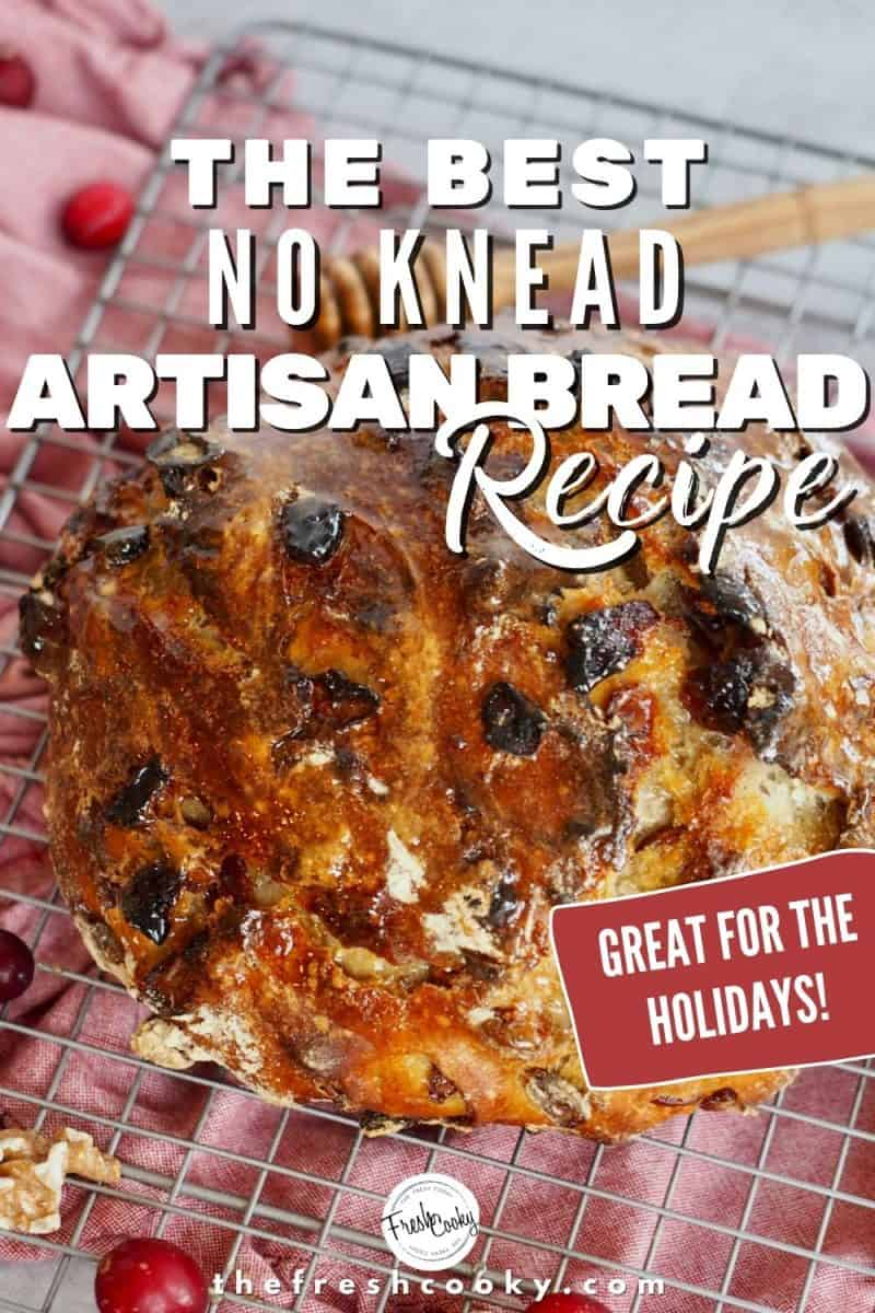 Top down shot of artisan no knead cranberry walnut bread on red napkin with honey drizzled on top.