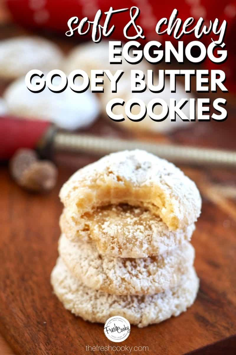 Pinterest image of stacked eggnog gooey butter cookies with nutmeg and grater in back