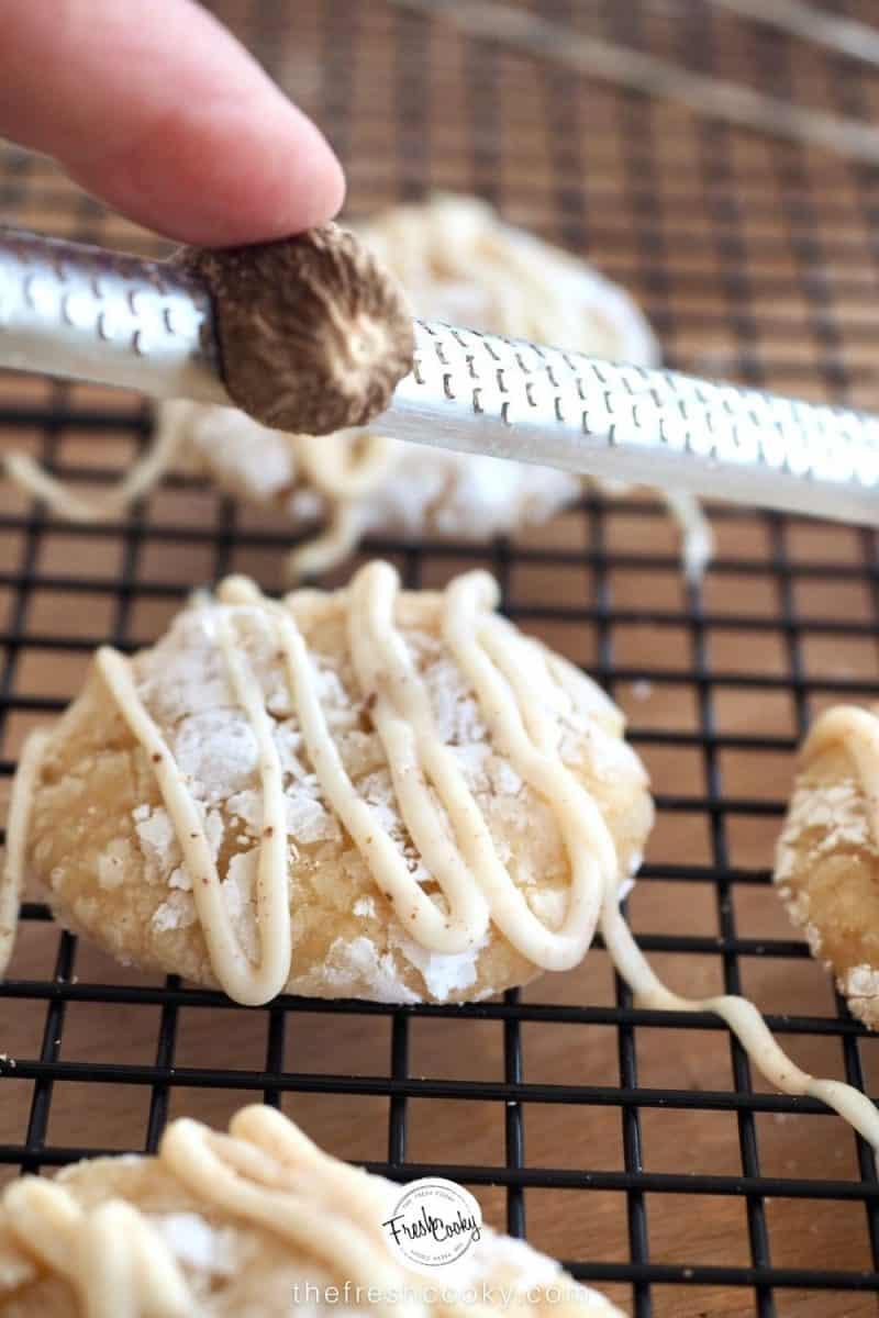fresh grated nutmeg on top of eggnog gooey butter cookies