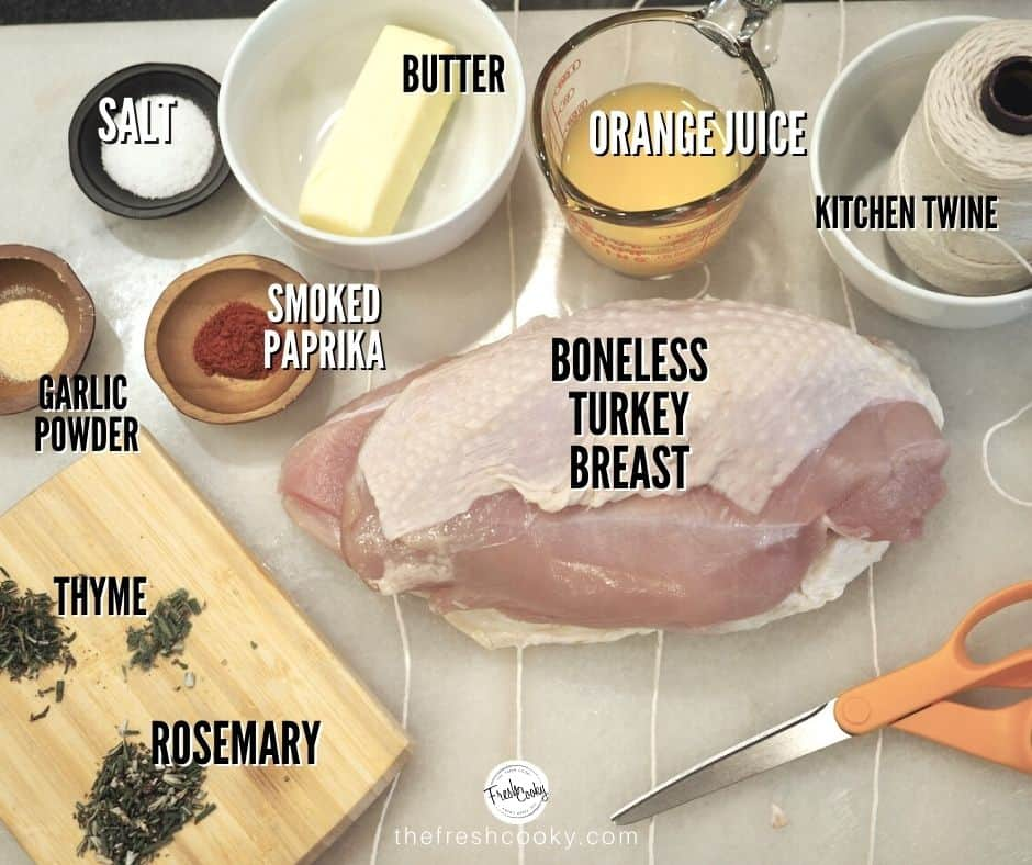 Ingredient shot for Instant Pot Turkey breast. L-R Salt, butter, orange juice, kitchen twine, boneless turkey breast, rosemary, thyme, smoked paprika, garlic powder