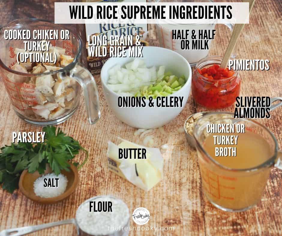 Ingredient shot for Wild Rice Supreme Casserole. L-R cooked chicken, wild rice blend mix, half and half, pimientos, slivered almonds, chicken broth, butter, flour, salt, parsley, onions and celery