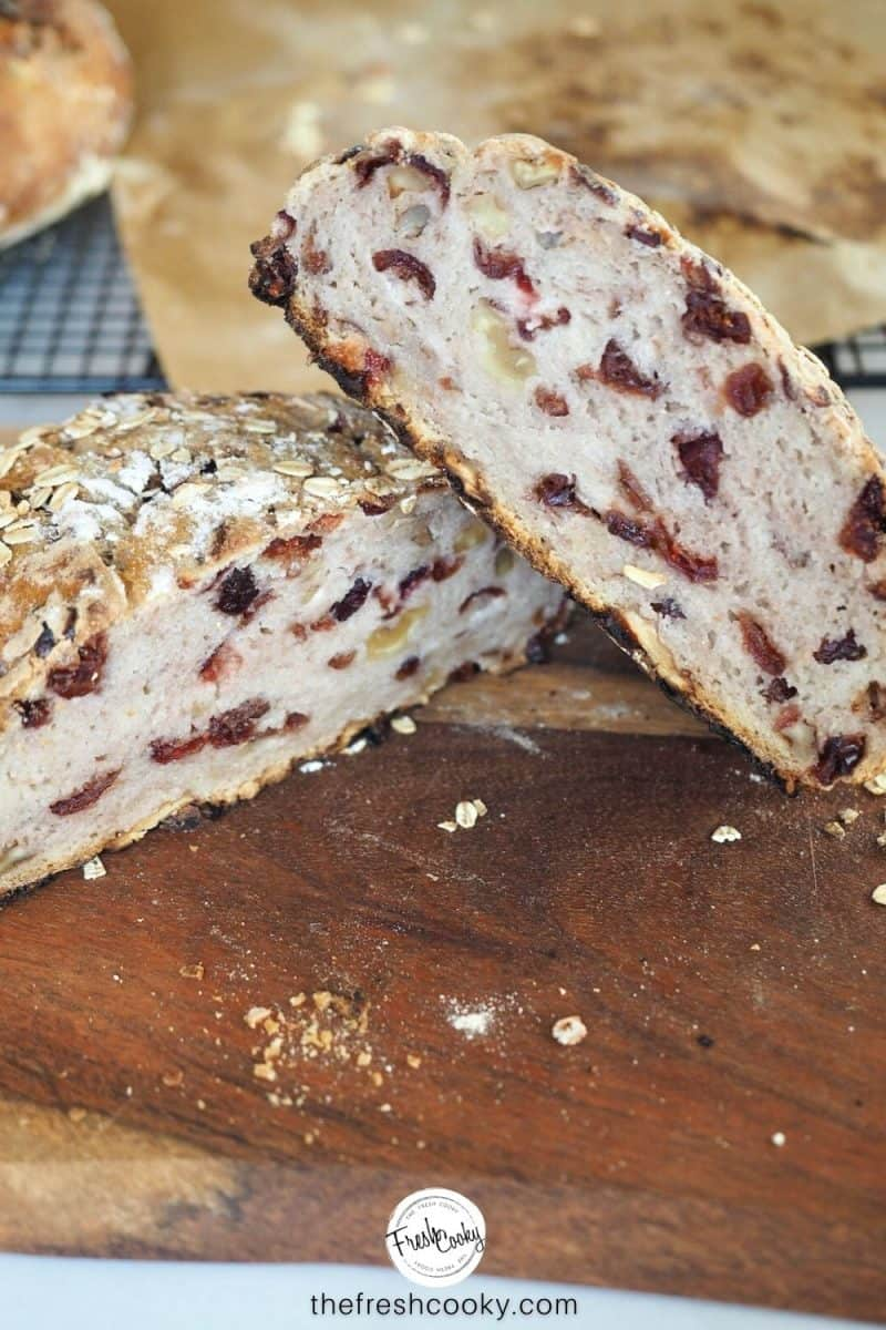 gluten free cranberry nut loaf sliced in half and leaning on top of the other showing the insides of the bread.