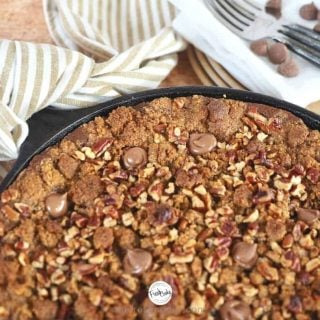 Facebook image portion of chocolate pumpkin graham crisp in cast iron skillet with tea towel tied to hot handle.