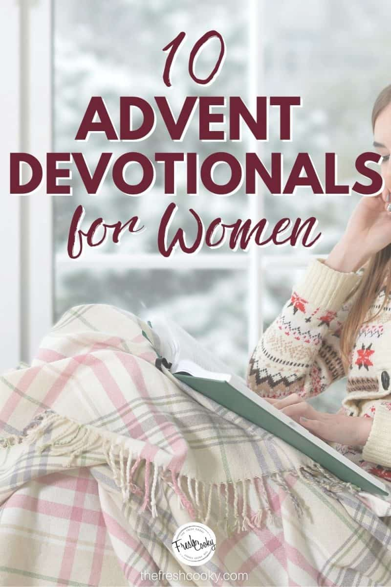 Pinterest Image for Best Advent devotionals for women with woman sitting near window, with book and snuggly blanket while it snows outside