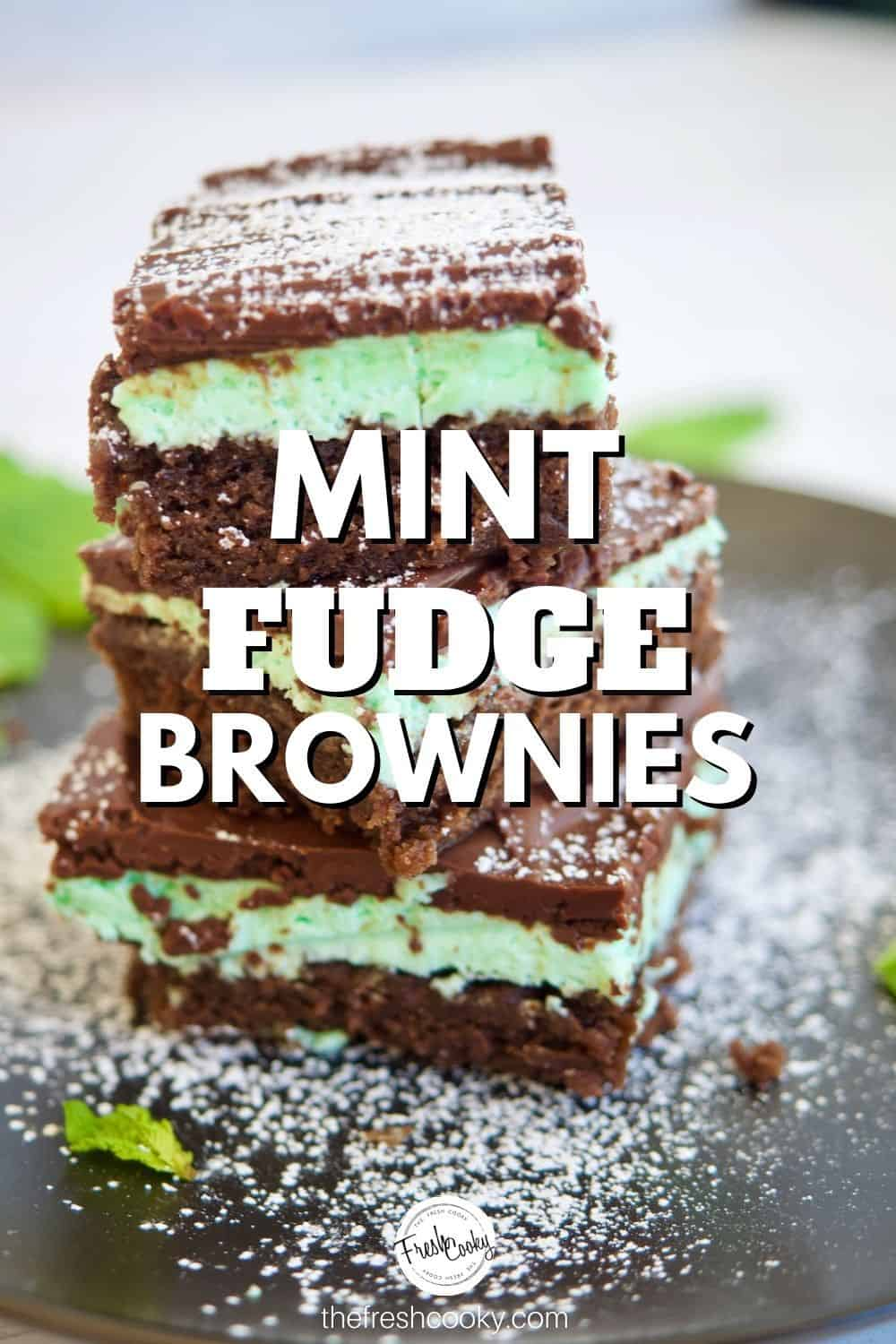 Triple layered Mint Brownies! Yes please! Fudge brownie layer, fluffy minty creme de menthe buttercream middle with a rich chocolate ganache top! The perfect Christmas cookie, bar cookie. Makes a lot! High altitude instructions included. #thefreshcooky #grasshopper #fudgemintbrownies #holidaybakingrecipes via @thefreshcooky