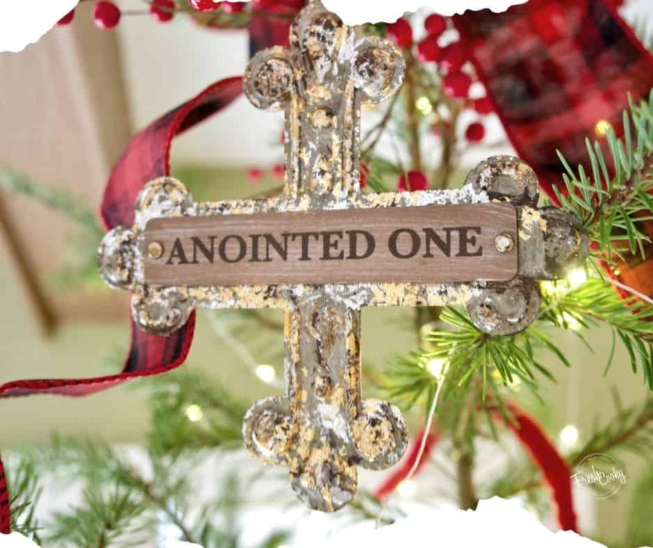 Image of cross that says Anointed One on Christmas tree