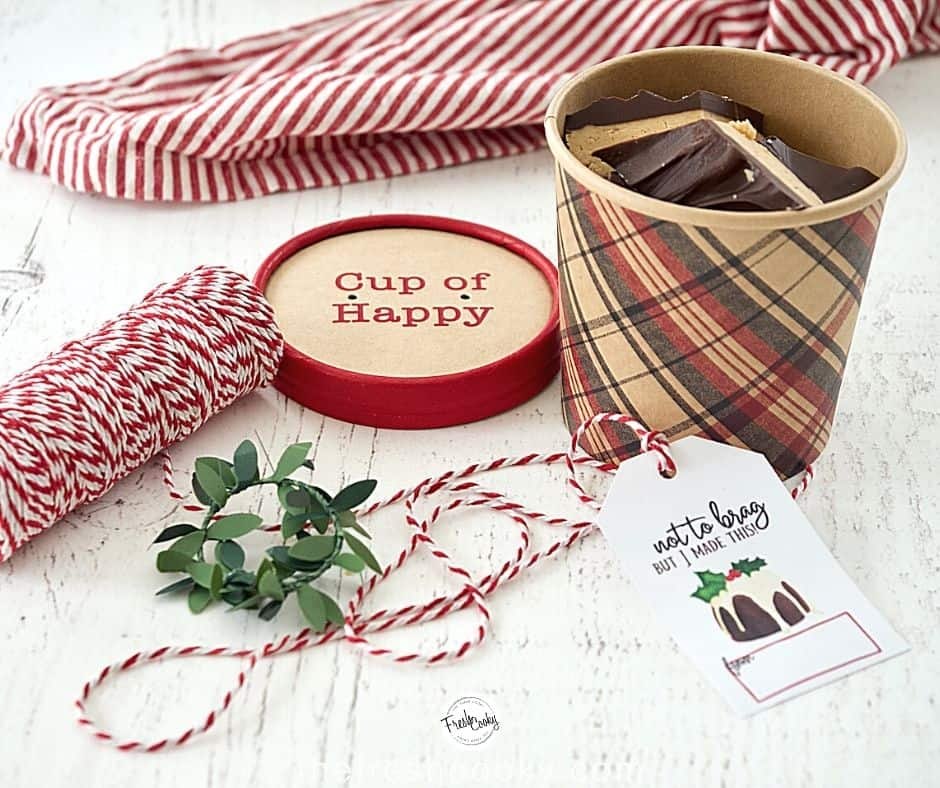 Bucket of Buckeye Bark with bakers twine and gift label with decorations.