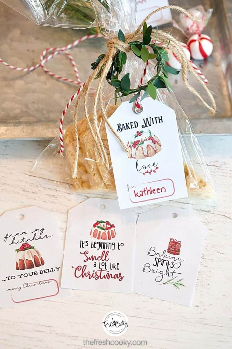 cello wrapped cookie tied with free gift tag that says, baked with love, along with three other free printable gift tags