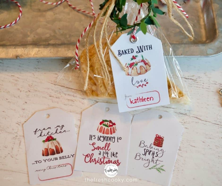 Facebook image of 4 different labels that can be used on baked goods, from the kitchen of, smells a lot like Christmas, free printable gift tags.