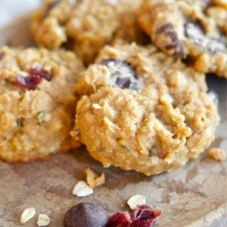 Image of stoneplate with 4 healthy gluten free breakfast cookies with almonds, cranberries and chocolate chip on plate, natural linen napkin under the plate.