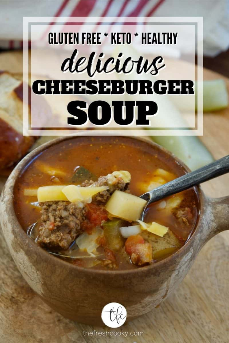 Pinterest image for healthy cheeseburger soup wiht image of bowl of soup with handle with ground beef, potatoes, pickles in the background.