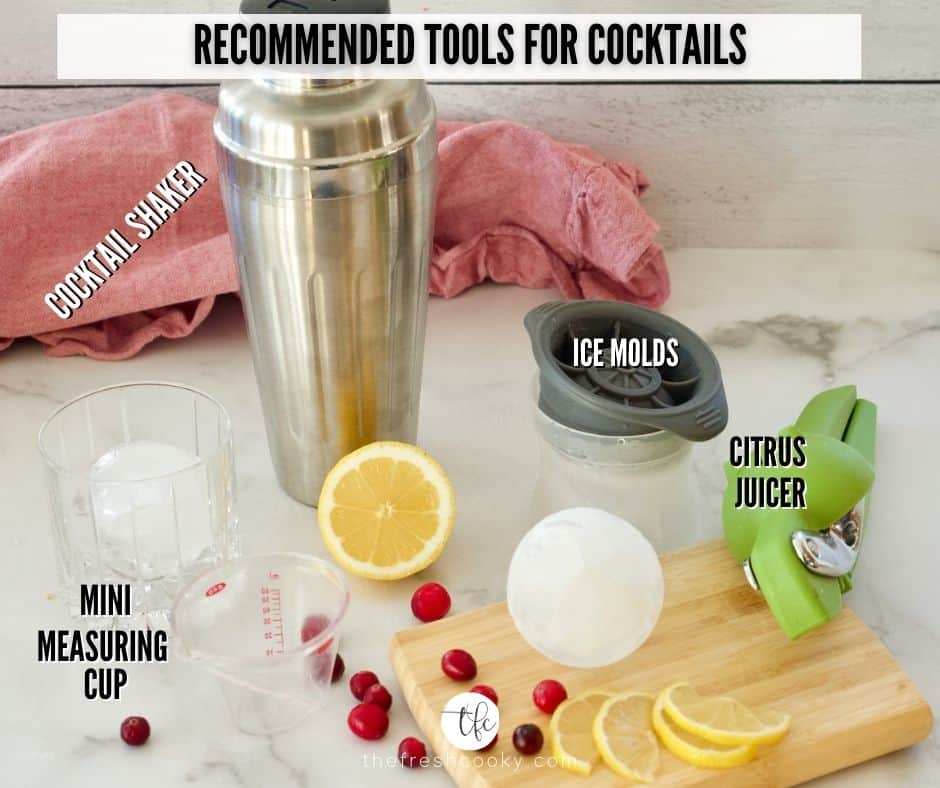 Image of Recommended tools to make Cranberry Bourbon Sour L-R Cocktail Shaker, spherical ice molds, citrus juicer and mini Oxo measuring cup