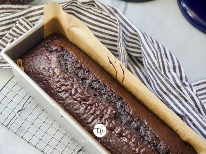 Easy Chocolate Loaf Cake on wire cooling rack out of the oven