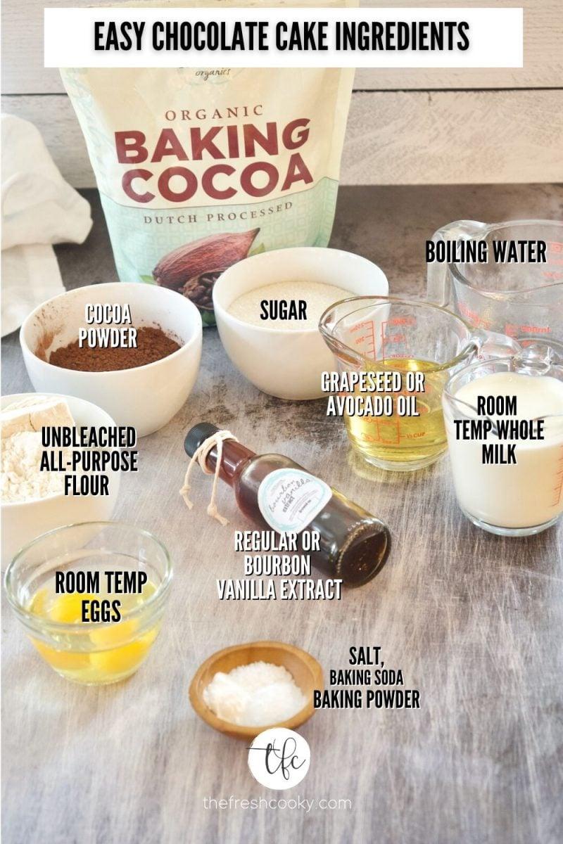 Easy Chocolate Loaf Cake Ingredient image. L-R Cocoa Powder, sugar, boiling water, milk, oil, baking powder, baking soda, vanilla, eggs, flour