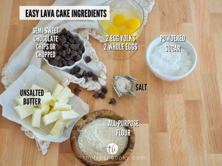 image of easy lava cake recipe ingredients. L-R unsalted butter, chocolate chips, eggs, powdered sugar, salt and all purpose flour